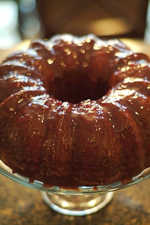 Brush the Berry Glazed Chocolate Cake with the raspberry glaze