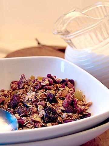 This budget friendly Homemade Granola contains whole grains along with pecans, dried berries, dried cherries, and golden raisins. From @NevrEnoughThyme https://www.lanascooking.com/homemade-granola/