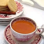 Spiced Tea (Russian Tea) is a mixture of warm tea, orange and lemon juices, infused with cloves and cinnamon. Served at all 1960s social functions! From @NevrEnoughThyme https://www.lanascooking.com/spiced-tea-a-k-a-russian-tea/
