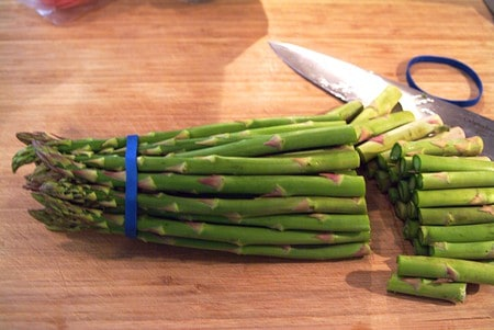 Prepping fresh asparagus for Roasted Asparagus