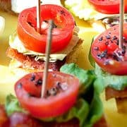 BLT Bites are perfect tiny appetizer sized single bite BLTs on sourdough bread. Serve with cocktails, as a first course, or as finger food for any party. https://www.lanascooking.com/blt-bites/