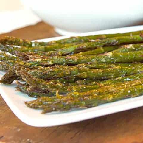 One of my favorite spring vegetables - fresh roasted asparagus. You'll only need four ingredients: asparagus, garlic-infused olive oil, salt and pepper. From @NevrEnoughThyme https://www.lanascooking.com/roasted-asparagus/