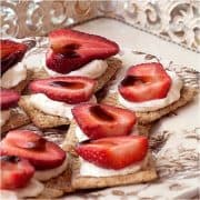 Strawberry Balsamic Cream Cheese Bites - an hors d'oeuvres with a lovely combination of sweet ripe strawberries, balsamic vinegar, and cracked black pepper. https://www.lanascooking.com/strawberry-balsamic-appetizer/