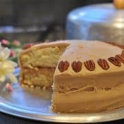 Southern caramel layer cake - moist yellow cake layers topped with a caramel frosting. A favorite of everyone in our family. https://www.lanascooking.com/caramel-layer-cake