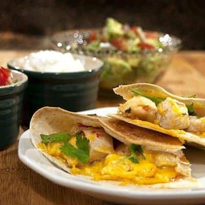 Healthy low-fat Chicken Quesadillas served up with a bright, fresh Avocado Salad. Enjoy these two complimentary recipes for an easy, guilt-free dinner. From @NevrEnoughThyme https://www.lanascooking.com/chicken-quesadillas-with-avocado-salad-cooking-to-combat-cancer/