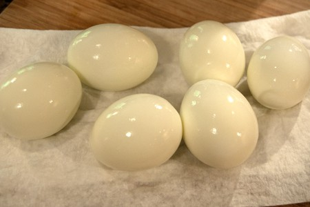 Peeled, hard boiled eggs for classic deviled eggs
