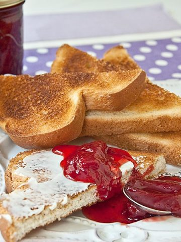 Homemade Strawberry Jam made with fresh, ripe strawberries, sugar, and lemon juice and no preservatives. From @NevrEnoughThyme https://www.lanascooking.com/strawberry-jam/