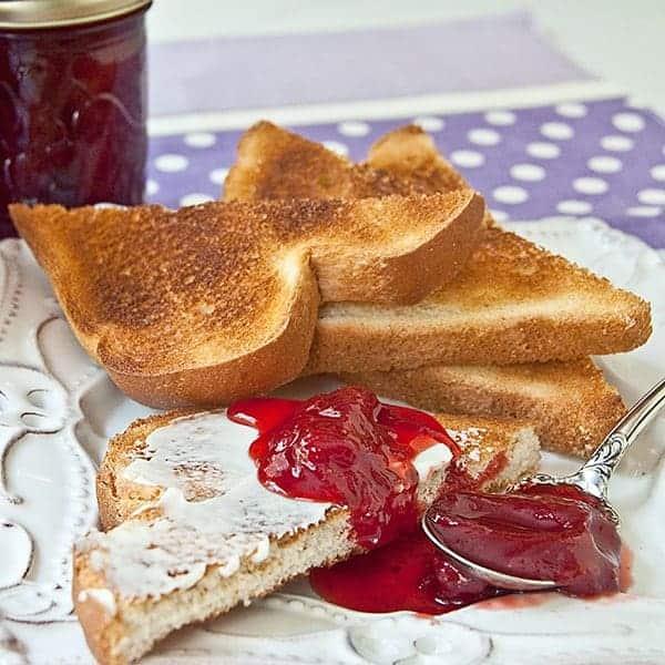 Homemade Strawberry Jam made with fresh, ripe strawberries, sugar, and lemon juice and no preservatives. https://www.lanascooking.com/strawberry-jam/