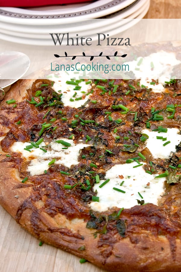 White Pizza with lots of fresh herbs, onions, and cheese, but no tomato sauce. A great change of pace for your weekly pizza night. From @NevrEnoughThyme https://www.lanascooking.com/white-pizza/
