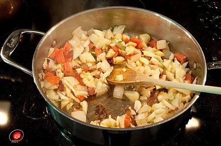 Cook the zucchini pulp, tomato, and onion