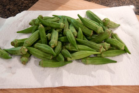 Wash and dry okra pods