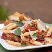 Pasta with Italian Sausage and Tomatoes - a quick and easy weeknight dinner of Penne pasta with Italian sausage and tomatoes. https://www.lanascooking.com/pasta-with-italian-sausage-tomatoes/