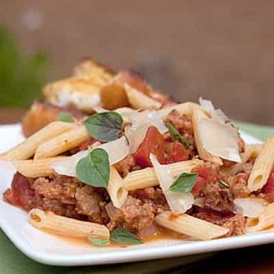 Pasta with Italian Sausage and Tomatoes - a quick and easy weeknight dinner of Penne pasta with Italian sausage and tomatoes. From @NevrEnoughThyme https://www.lanascooking.com/pasta-with-italian-sausage-tomatoes/