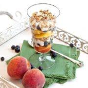Peach Blueberry Yogurt Parfait. A summery yogurt parfait - layered ripe, juicy sweet peaches, blueberries and vanilla yogurt topped with lowfat granola. https://www.lanascooking.com/peach-blueberry-yogurt-parfait/