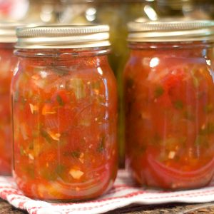 A home canning recipe for a Basic Salsa featuring fresh tomatoes. Make it as mild or spicy as you like. Save a little summer flavor for colder weather. From @NevrEnoughThyme https://www.lanascooking.com/basic-salsa/