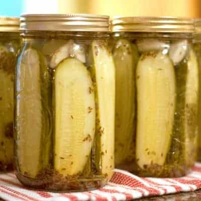 Our family's favorite dill pickles - Kosher dills with lots of fresh dill and garlic. Tested and approved safe canning recipe for shelf stable storage. From @NevrEnoughThyme https://www.lanascooking.com/favorite-kosher-dills/