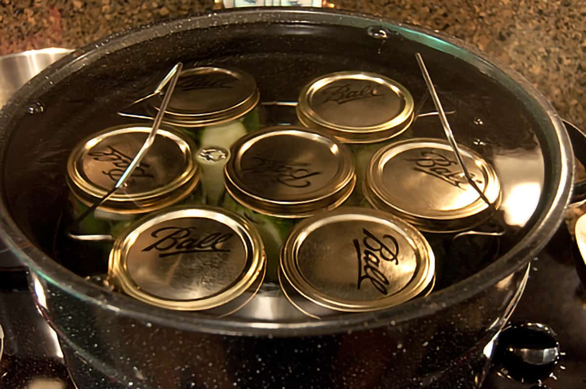 Seven filled jars in a water bath canner