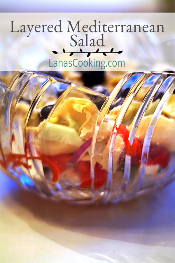 Layered Mediterranean Salad - a layered salad using lots of Greek ingredients. Perfect for days when it's too hot to cook. https://www.lanascooking.com/layered-mediterranean-salad/