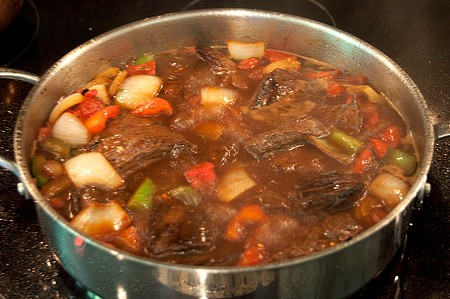 Add beef broth to the meat and veggies