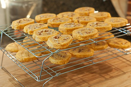 Baked pinwheels cooling on a rack.