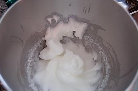 Beaten egg whites in a mixing bowl.