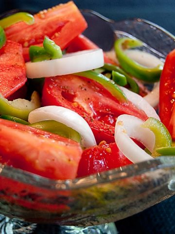 This vintage recipe for Fire and Ice Tomatoes is a sweet-tart salad with late summer tomatoes, bell peppers, and sweet Vidalia onions. From @NevrEnoughThyme https://www.lanascooking.com/fire-and-ice-tomatoes/