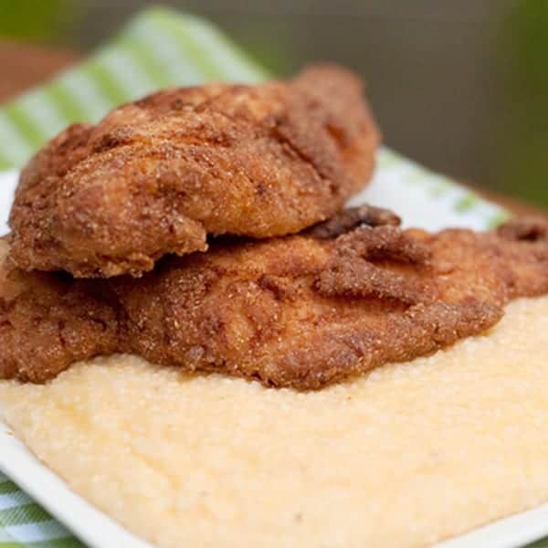 """Crispy, golden brown fried catfish fillets with a side of creamy, cheesy grits. The centerpiece of any southern """"fish fry."""" From @NevrEnoughThyme http://www.lanascooking.com/fried-catfish-with-cheese-grits"""