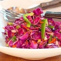 Red cabbage slaw with a sweet and tangy vinegar dressing. This slaw has no mayonnaise in the dressing so it's very low in calories. From @NevrEnoughThyme https://www.lanascooking.com/red-cabbage-slaw/