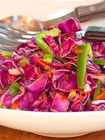 Red cabbage slaw with a sweet and tangy vinegar dressing. This slaw has no mayonnaise in the dressing so it's very low in calories. https://www.lanascooking.com/red-cabbage-slaw/