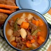 Pressure Cooker Beef Stew - a hearty beef stew with potatoes, carrots, green beans, and tomatoes can be on the table in minutes when you use a pressure cooker. https://www.lanascooking.com/beef-stew-in-the-pressure-cooker/