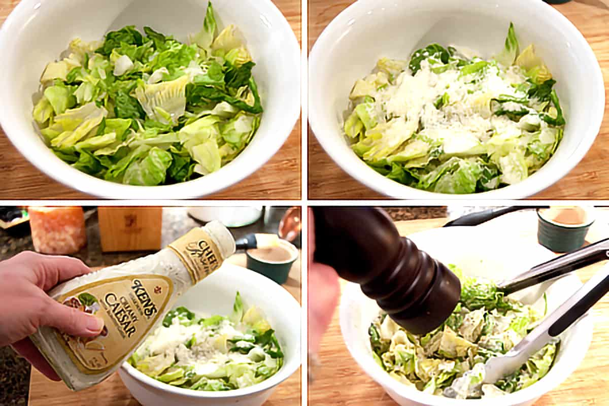 Caesar salad being mixed in a bowl.