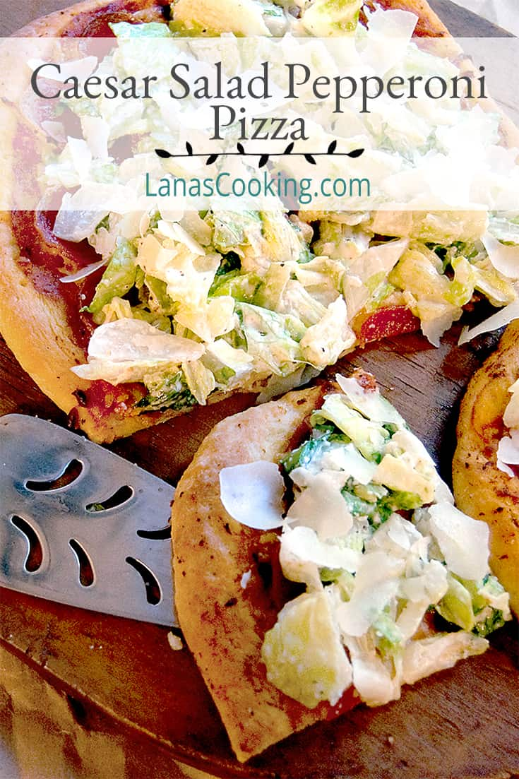 Caesar Salad Pepperoni Pizza presented on a wooden board for serving with title text overlay.