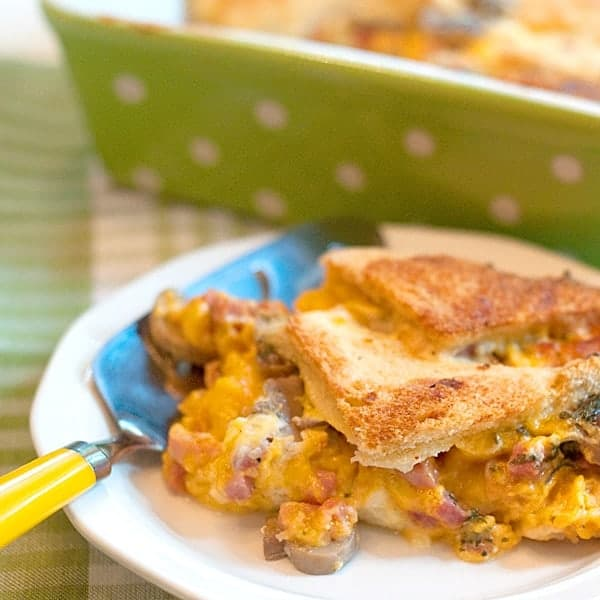 This ham and cheese strata contains layers of ham, cheese and mushrooms with bread, eggs and milk for a fabulous weekend or special occasion breakfast. From @NevrEnoughThyme https://www.lanascooking.com/ham-and-cheese-strata/