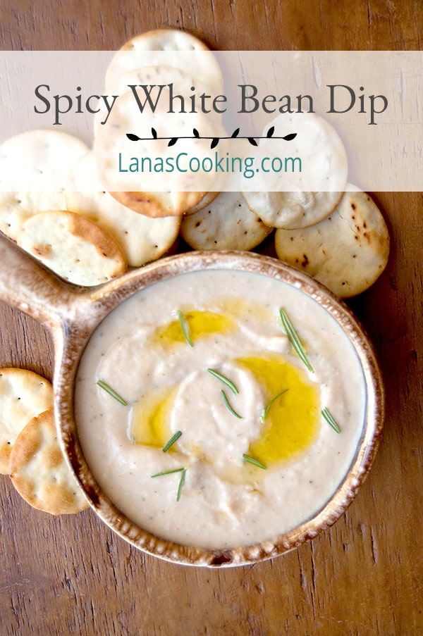 Add this Spicy White Bean Dip to your next tailgate menu or serve as an appetizer or snack for any occasion. From @NevrEnoughThyme https://www.lanascooking.com/spicy-white-bean-dip/