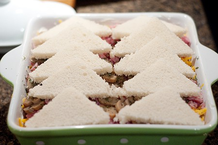 Bread triangles on top of strata.