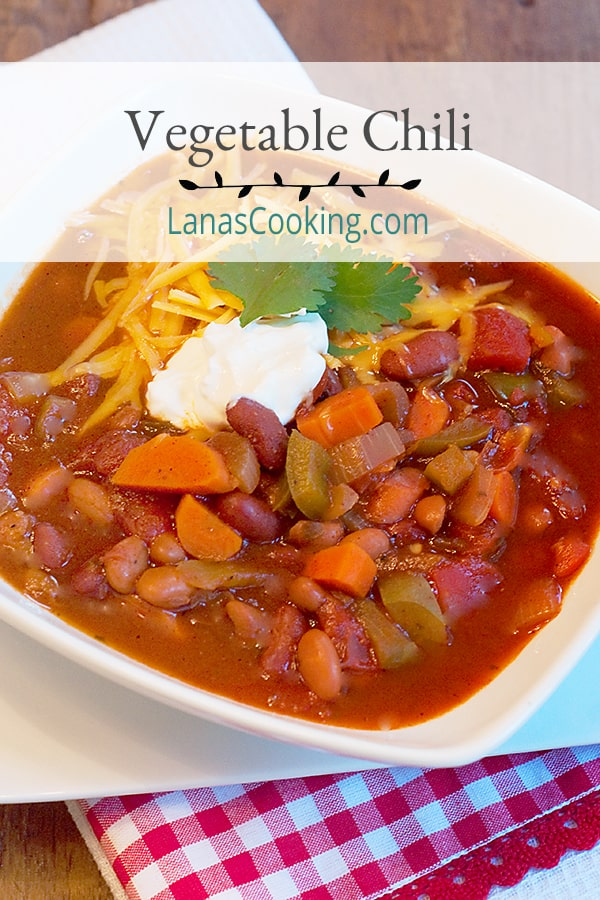 Vegetable Chili - this recipe for meatless vegetable chili is hearty, spicy and full of beans and veggies. Make it truly vegetarian with a vegetable stock. https://www.lanascooking.com/vegetable-chili/