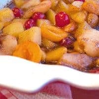 Baked Fruit is a great Thanksgiving side dish of baked winter fruits with brown sugar and spices. A nice complement to the savory sides. From @NevrEnoughThyme https://www.lanascooking.com/baked-fruit/