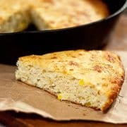 This Cheesy Chili Cornbread is a southern style cornbread with loads of sharp cheddar cheese and green chilies. https://www.lanascooking.com/cheesy-chili-cornbread