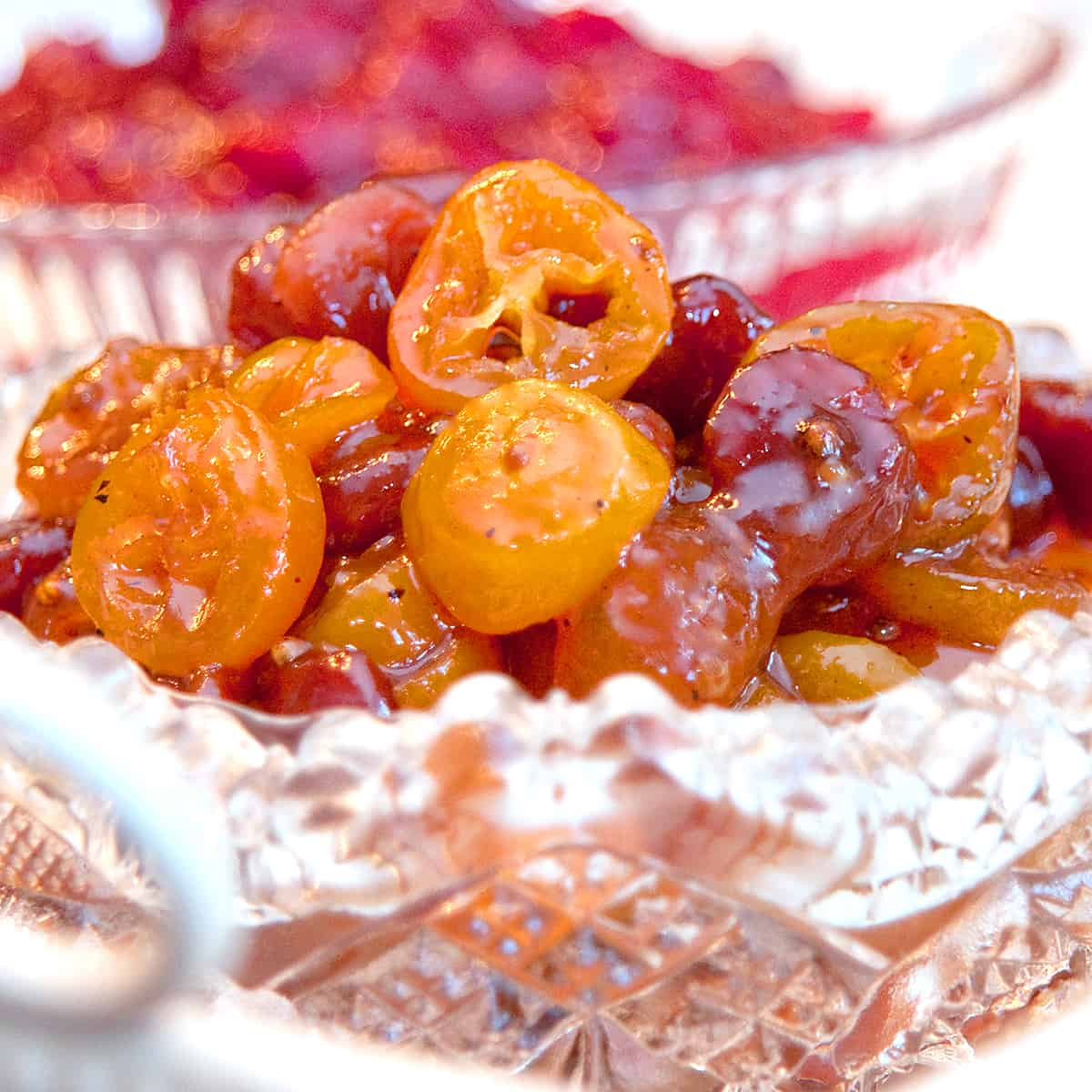 Kumquat and Dried Cherry Chutney in a cut glass serving dish.