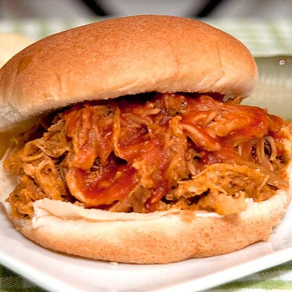 Slow Cooker Pulled Pork - use my fool-proof slow cooker method for preparing southern style pulled pork shoulder. Serve with your favorite barbecue sauce. From @NevrEnoughThyme https://www.lanascooking.com/slow-cooker-pulled-pork/