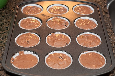 into prepared muffin pan using a scant 1/3 cup batter for each muffin ...