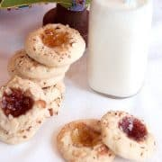 Thumbprint Jewels are tender, lemon-scented cookies, topped with nuts and their centers are filled with jam. From @Nevrenoughthyme https://www.lanascooking.com/thumbprint-jewels/