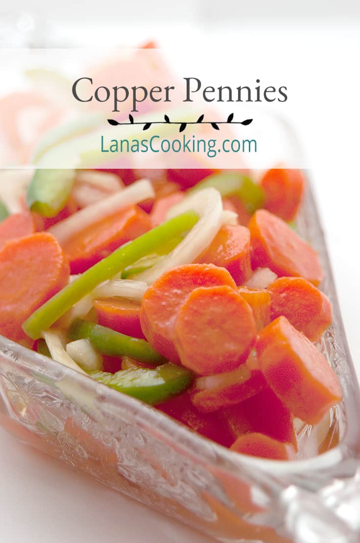 Copper Pennies salad in a decorative cut glass bowl. Text overlay for pinning.