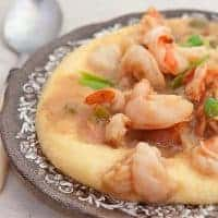 Shrimp and Grits - Sauteed shrimp with bacon, garlic and green onion served over creamy, stone-ground grits with cheddar cheese. From @NevrEnoughThyme https://www.lanascooking.com/shrimp-and-grits/