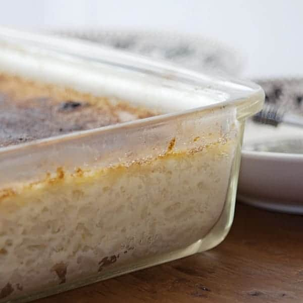 This Baked Rice Pudding with a brulee topping is rich with eggs, sugar, raisins, and milk. From @NevrEnoughThyme https://www.lanascooking.com/baked-rice-pudding/