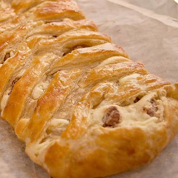 Candied Pecan Cheese Braid - a beautifully golden cheese braid created with puff pastry, a cream cheese filling, and candied pecans. From @NevrEnoughThyme https://www.lanascooking.com/candied-pecan-cheese-braid/