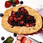 Berry Crostata - this mixed berry crostata combines strawberries and blueberries in a pie crust to create a free-form tart. From @NevrEnoughThyme https://www.lanascooking.com/berry-crostata/