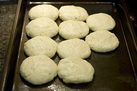 Place the biscuits on a baking pan with the sides touching