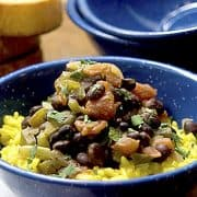 Black Beans with Saffron Rice - Black beans simmered with tomatoes and aromatic vegetables and served over fragrant saffron rice. https://www.lanascooking.com/black-beans-and-saffron-rice/