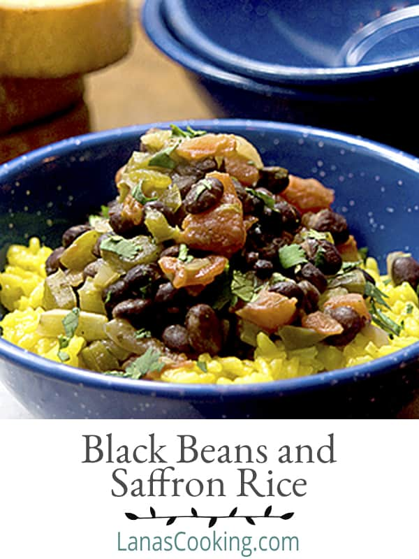 Black Beans with Saffron Rice - Black beans simmered with tomatoes and aromatic vegetables and served over fragrant saffron rice. From @NevrEnoughThyme https://www.lanascooking.com/black-beans-and-saffron-rice/
